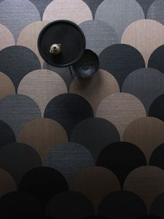 Bolon flooring using rich, metallic Now colours and cut in Studio shape, Scale.