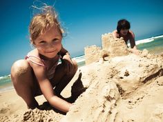 Kids building sandcastles at Min y Don Holiday Park