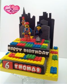 A LEGO CAKE based on the Movie that was recently released. The stars Emmet the builder and Wyldstyle both in fondant on a chocolate lego cake. Aug 2014