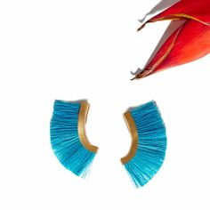 "The ""Pony Tail Ear Cuff II"" in Turquoise - 18 Karat Gold and Horse Hair. Online at www.ParmeMarin.com #ParmeMarin #Colorful #Statement"