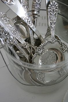 Tea strainers Old Silver