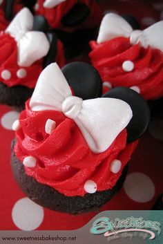 Minnie Mouse Cupcake. This link doesn't work anymore, but I like basic concept of red icing + polka dot sprinkles