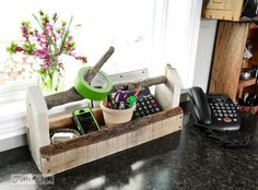 #4. Make a reclaimed wood toolbox phone organizer / 10 quirky, upcycled kitchen must haves you won't want to live without! By Funky Junk Interiors for ebay.com