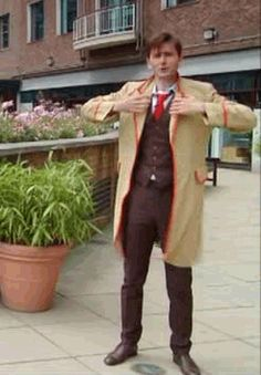 This just in. David Tennant puts on father-in-law's coat. Looks fantastic. ;) #DoctorWho