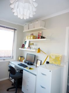 Fresh office space. Love the lamp. The desk was made from a selection of Ikea kitchen cabinets, totally genius!