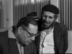 """From the movie """"Sallah Shabbati."""" Notice the way in which Sallah (a Mizrachi) is portrayed, in contrast to the Ashkenazi clerk he is speaking to."""