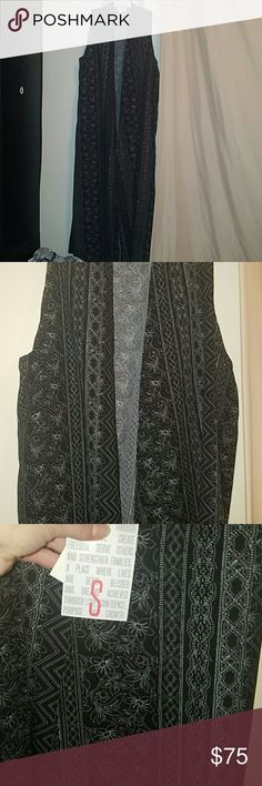 Lularoe Gorgeous Black&white Joy NWT Beautiful black and white lularoe printed Joy In Small size . Brand new with tag attached . Was debating on posting this,  as I wouldn't mind keeping it for myself.. LuLaRoe Tops Blouses