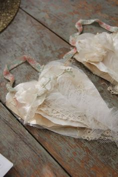 Shabby chic hearts layer some coffee filters, sewing patterns and tulle ... then top with some lace and flowers