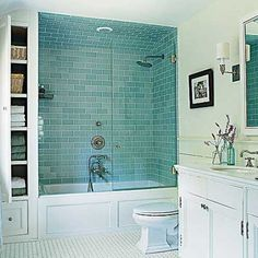 I like the idea of enclosing the tub against the back wall with a glass door. And the tiles are gorgeous.