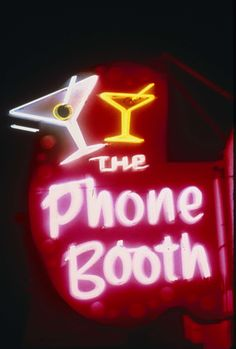 The neon sign for the Photo Booth Bar in Reno, 1986.  Part of UNLV Libraries photo digital collection.  #UNLV