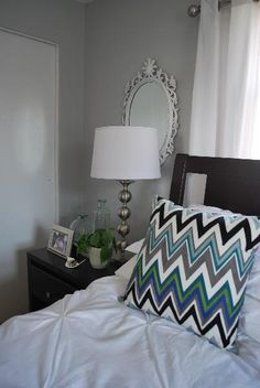Gray blue walls paint color, target zigzag pillows, white mirrors, silver lamps and white grommet drapes. White Bedroom Decor, Master Bedroom Interior, Master Bedroom Makeover, Bedroom Colors, Home Decor Bedroom, Bedroom Ideas, Gray Bedroom, Blue Painted Walls, Grey Walls
