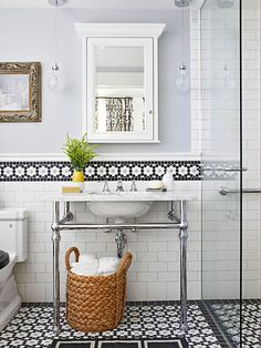 Love the floor and accent tile (and the basket is a smart way to store towels when you have a pedestal sink)