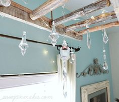 Catch the light that filters through your windows with these gorgeous crystal objects, suspended from a ceiling-mounted ladder and strung with tiny fairy lights.  Get the tutorial at Meegan Makes.   - CountryLiving.com