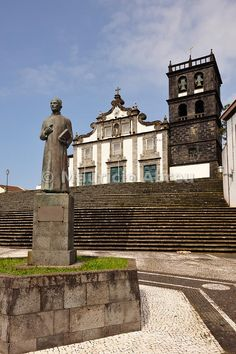 Gaspar Frutuoso statue and the Motherchurch of Ribeira Grande, São Miguel. Azores islands