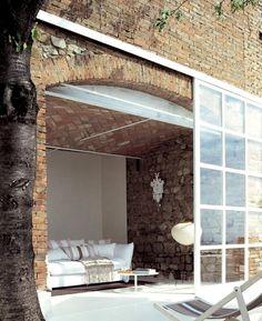 Love the brick and modern door/window.
