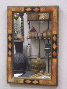 13.5in H x 8.75 in W. These Camel bone mirrors are a display of artistic skill and unique blend of classic and contemporary art. They offers you a combination of style and utility. Measurement: : 13.5in H x 8.75 in W.