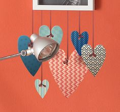 A fantastic design illustrating several hanging hearts with each displaying a different texture. Create cool 3-D effects on the walls of your home with this beautiful sticker! #Creative #Love #Hearts