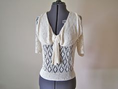 1930s knitted cotton blouse with a giant bow collar