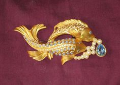 "This sale is for a 'Sea Shimmer' rhinestone double koi fish pin. The pin measures 2"" by 4"" and has a 'C' clasp which has a locking mechanism. All rhinestones are present and shiny. The cabochons are in very good condition. 