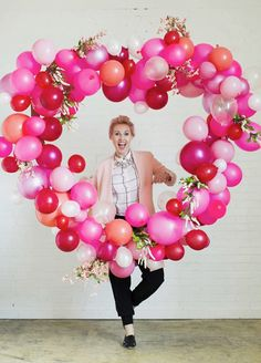 9 Wedding Photo Backdrops That Will Blow Up Your Insta Feed - Red, pink, and white heart balloon photo backdrop
