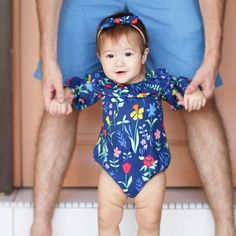 Those thigh rolls though! I just can't get enough of my baby girl in this beautiful blue floral romper. Get it while it's still in stock! Link in my profile.