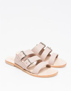 From Sol Sana, an elegant leather slip on sandal with triple straps. Features leather uppers, double buckle adjustment closures, leather lining and leather sole.  • Leather slip on sandal with triple straps • Leather uppers • Double buckle adjustment