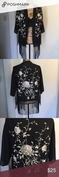Embroidered black cover up. Very pretty cover up top. Perfect with some jeans or over a cute 👙 bathing suit. The size says one size but the measurement are 18 inches width 16 inches length. Abercrombie & Fitch Tops Tunics