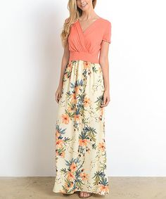 Take a look at this Coral Floral Surplice Maxi Dress today!