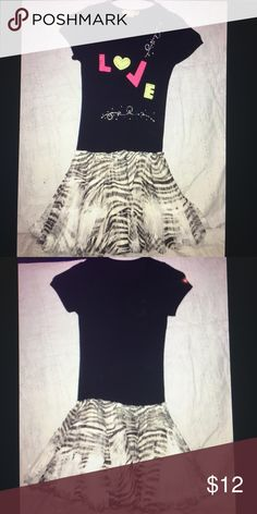 Girls youth Size 8 Dress Girls Youth size 8 Dress. This dress is super cute and comfy! The top is T-shirt style and material with a layered tule skirt. With zebra print. The print came looking patchy it is not from ware that isnhownits supposed to look! This dress is in New Condition with no stains or rips! My kids loved this dress Dresses Casual
