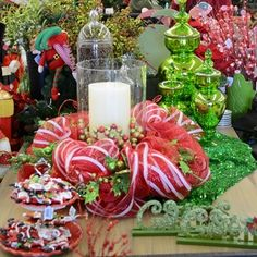 A simple centerpiece for the holiday table using decomesh, green mercury glass and traditional colors with a twist.