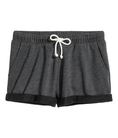 Black melange. Short shorts in melange sweatshirt fabric with elasticized drawstring waistband. Sewn cuffs at hems.