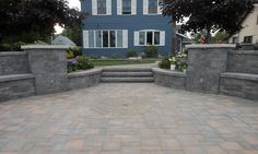 A stunning walkway leading to a stunning outdoor living space. This gorgeous backyard was created with pavingstones, wallstones, and steps by Cambridge with Armortec.