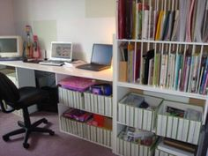 This was my very first scrapbooking room.  I repurposed ikea plate racks for the shelves (which works amazing for the books and papers - as seen on the top shelves) - and without the bars also looks good with baskets! LOVE IT!