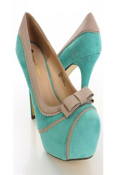 The features for these heels include a faux suede upper with a contrast faux leather scalloped trim, bow tie accent, scoop vamp, round closed toe, smooth lining, and cushioned footbed. Approximately 5 inch heels and 1 1/2 inch platforms.