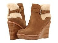 UGG ANAIS Chestnut Suede Shearling Boots    Love your cold weather look with the UGG® Australia Anais wedge bootie.  •Suede or leather upper with exposed sheepskin for much added appeal. •Removable strap with antique metal buckle for added style. •Soft leather-lined footbed ensures an abrasion-free environment for all-day wear. •Sheepskin lined forefoot for added comfort and warmth. •Poron® foam-cushioned footbed massages the foot with each and every step.
