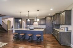 Luxurious chef inspired kitchen with large center island and hidden pantry