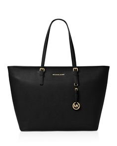 """Bring all your essentials onboard with the roomiest iteration of Michael Michael Kors' travel-ready tote.   Leather   Imported   Double handles      Open top; unlined   Key fob    20.5""""L x 8""""W x 13""""H;"""