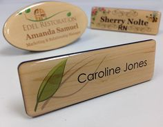 "Domed wood grain name tags. Comes in standard size of 1"" x 3"". You can get yours…"