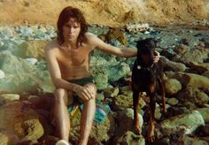 Jim Morrison with Thor (Ray Manzarek's brother Jim's doberman), 1965