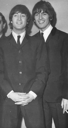 1965 - John Lennon and George Harrison.
