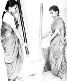women pounding the spices into powder.