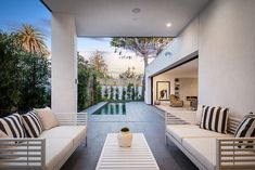 This modern house has a covered outdoor lounge area. #OutdoorLounge #OutdoorSpace