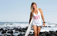 Empowered: This image is empowering because Sally Fitzgibbons is a strong surfer and an inspiring sportswoman.