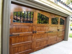 Wood garage door with substantial windows to let the light in.  Ooooo how I love a pretty driveway and lovely garage doors!