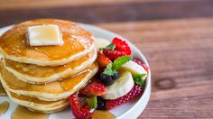 Pancakes vs. Waffles: Pick a stack of cakes with fresh fruit, butter, and maple syrup. Get the recipes: http://chfstps.co/1EmbAWw