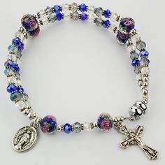 A full rosary created with genuine crystal beads & a magnetic closure. The strong magnet makes taking the bracelet on and off easy for everyone! Each Our Father bead has a rose design in embedded in the crystal & is surrounded by delicate Hail Mary beads. Rosary Bracelet, Bracelet Clasps, Bracelets, Clear Crystal, Crystal Beads, Confirmation Sponsor, Things About Boyfriends, Hail Mary, Religious Jewelry