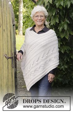 Winter's Heart - Knitted poncho with cables, bubbles and lace pattern. Sizes S - XXXL. The piece is worked in 2 strands DROPS Baby Merino.  Free knitted pattern DROPS 184-5