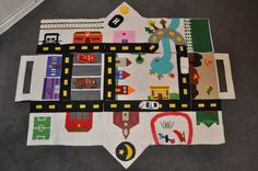 Felt Car Play Mat House.  Totally inspired by Narelle at http://www.cookcleancraft.com/2009/01/tutorial-felt-car-play-mathouse.html