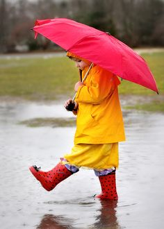 Play in the rain with an umbrella. Jump in puddles. *DONE* We don't own an umbrella but the kids had fun anyway!