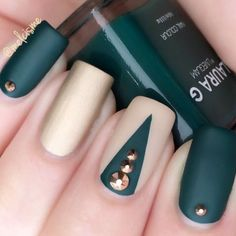 You may think of orange, red and yellow when it comes to fall, but deep jade is also a perfect hue for the season. Add a matte topcoat to give this dark autumn look an ultra-modern feel. Click through for the tutorial and more fall nail art ideas.